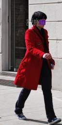 red coat on the street